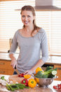 Smiling woman cutting ingredients for salad Stock Images