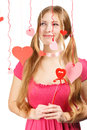 Smiling woman with designer red and pink paper valentine hearts beautiful young hanging on colored threads isolated on white Stock Images