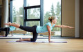 Smiling woman doing exercise in gym fitness sport training yoga and people concept Stock Image