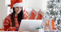 Smiling woman doing online Christmas shopping Royalty Free Stock Photo