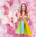Smiling woman in dress with many shopping bags retail and sale concept Stock Photo