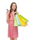 Smiling woman in dress with many shopping bags retail and sale concept and credit card Royalty Free Stock Photos