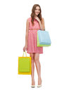 Smiling woman in dress with many shopping bags retail and sale concept and high heels Royalty Free Stock Photography
