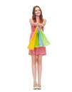 Smiling woman in dress with many shopping bags retail and sale concept and high heels Stock Image