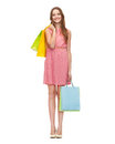 Smiling woman in dress with many shopping bags retail and sale concept and high heels Royalty Free Stock Images