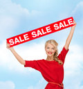 Smiling woman in dress with red sale sign shopping christmas and x mas concept Royalty Free Stock Photography