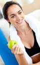 Smiling woman eating an apple after working out Stock Photography