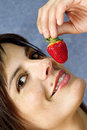 Smiling woman  eating strawberry fruit Stock Photos