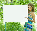 Smiling woman with empty billboard Royalty Free Stock Image