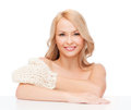 Smiling woman with exfoliation glove Stock Images