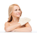 Smiling woman with exfoliation glove health spa and beauty concept Stock Photos