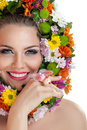Smiling woman with flowers young around head Royalty Free Stock Image