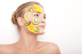 Smiling woman with fruit mask on her face isolated beautiful young cheerful white background Stock Images