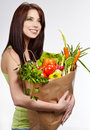Smiling woman with fruits and vegetables. Stock Photo