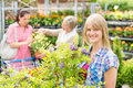 Smiling woman at garden centre shopping plants Royalty Free Stock Photo