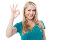 Smiling woman gesturing perfect sign everything is so awesome Stock Photography
