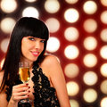 Smiling woman with a glass of champagne Stock Images
