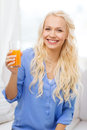 Smiling woman with glass of orange juice at home healthcare food and happiness concept young having breakfast Stock Photos