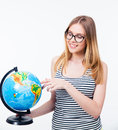 Smiling woman in glasses holding world globe Royalty Free Stock Photo