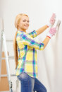 Smiling woman in gloves doing renovations at home repair renovation and concept Royalty Free Stock Photos