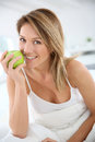 Smiling woman with green apple Royalty Free Stock Photo