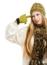 Smiling woman in green winter clothing young cap and gloves and knitted scarf gesturing isolated on white background Royalty Free Stock Photography