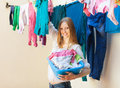 Smiling woman hanging clothes to dry on line Royalty Free Stock Images