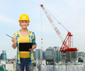 Smiling woman in helmet with clipboard Royalty Free Stock Photo