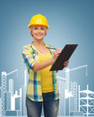 Smiling woman in helmet with clipboard repair construction and maintenance concept Royalty Free Stock Photos