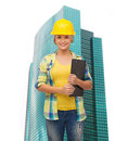 Smiling woman in helmet with clipboard repair construction and maintenance concept Stock Image