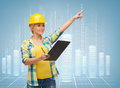Smiling woman in helmet with clipboard repair construction and maintenance concept pointing finger Stock Images