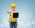 Smiling woman in helmet with clipboard repair construction and maintenance concept showing thumbs up Stock Photography