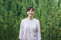 Smiling woman in the hemp field Royalty Free Stock Photo