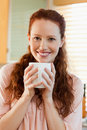 Smiling woman with her cup of coffee Royalty Free Stock Photo