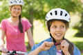 Smiling woman with her daughter riding a bicycle Stock Image
