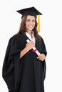A smiling woman with her degree as she looks at the camera Stock Photography