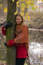 Smiling woman hoding tree Stock Photo