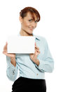 Smiling woman holding blank business card focus on face Royalty Free Stock Image