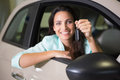Smiling woman holding car key Royalty Free Stock Photo