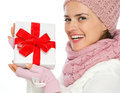 Smiling woman holding Christmas present box Royalty Free Stock Photo