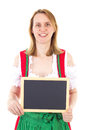 Smiling woman holding clean blackboard in dirndl Stock Photo