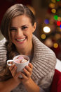 Smiling woman holding cup of hot chocolate Stock Photos