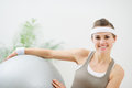 Smiling woman holding fitness ball Royalty Free Stock Images