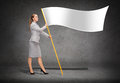Smiling woman holding flagpole with white flag Royalty Free Stock Photo