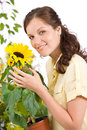 Smiling woman holding flower pot with sunflower Stock Images