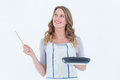 Smiling woman holding frying pan and wooden spoon Royalty Free Stock Photo