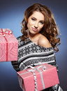 Smiling woman holding gift Stock Images