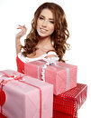 Smiling woman holding gift Royalty Free Stock Images