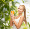 Smiling woman holding glass of orange juice Royalty Free Stock Photography