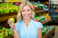 Smiling woman holding green apple Royalty Free Stock Photo